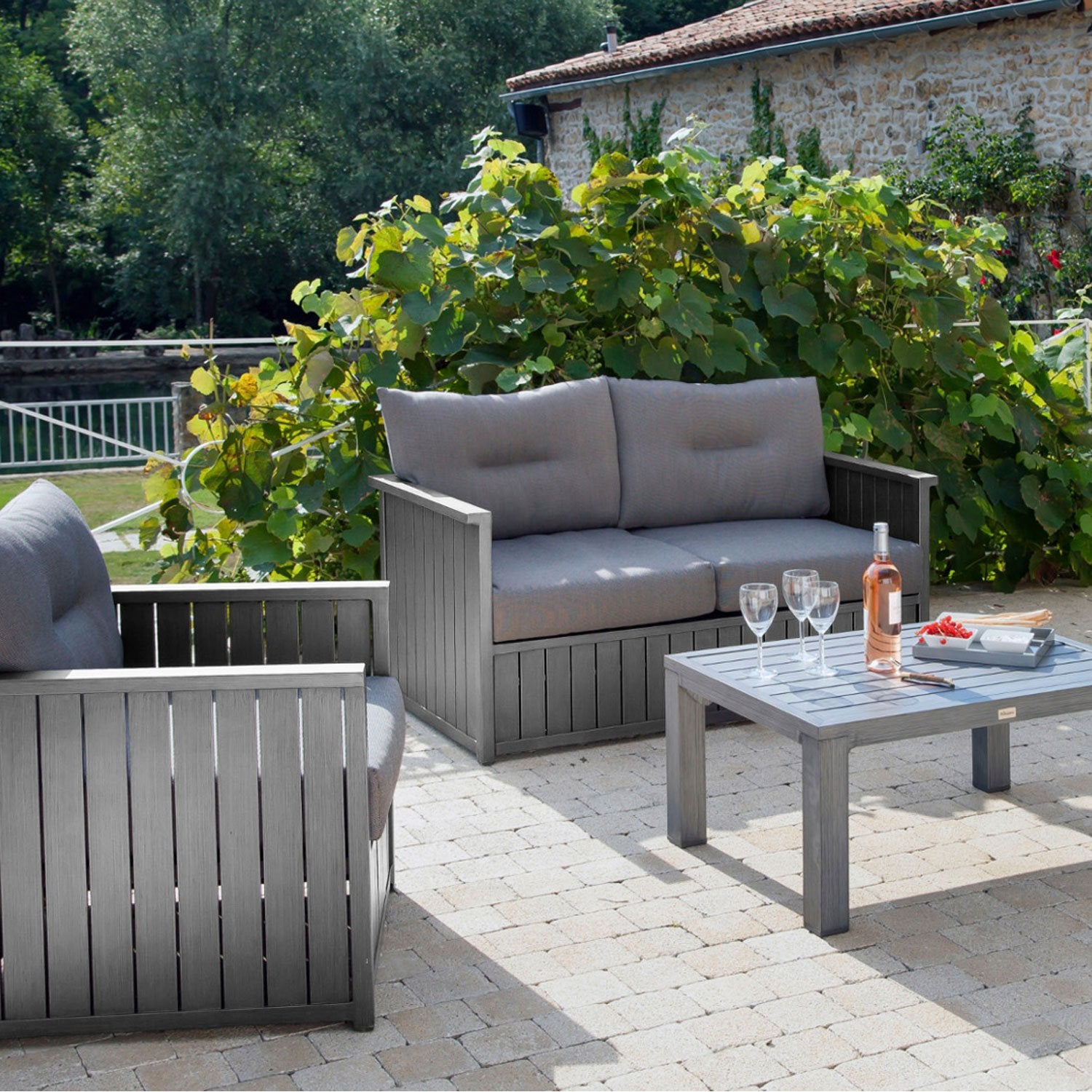 Canap 2 places de jardin milano gris pro loisirs leroy for Table exterieur 2 places