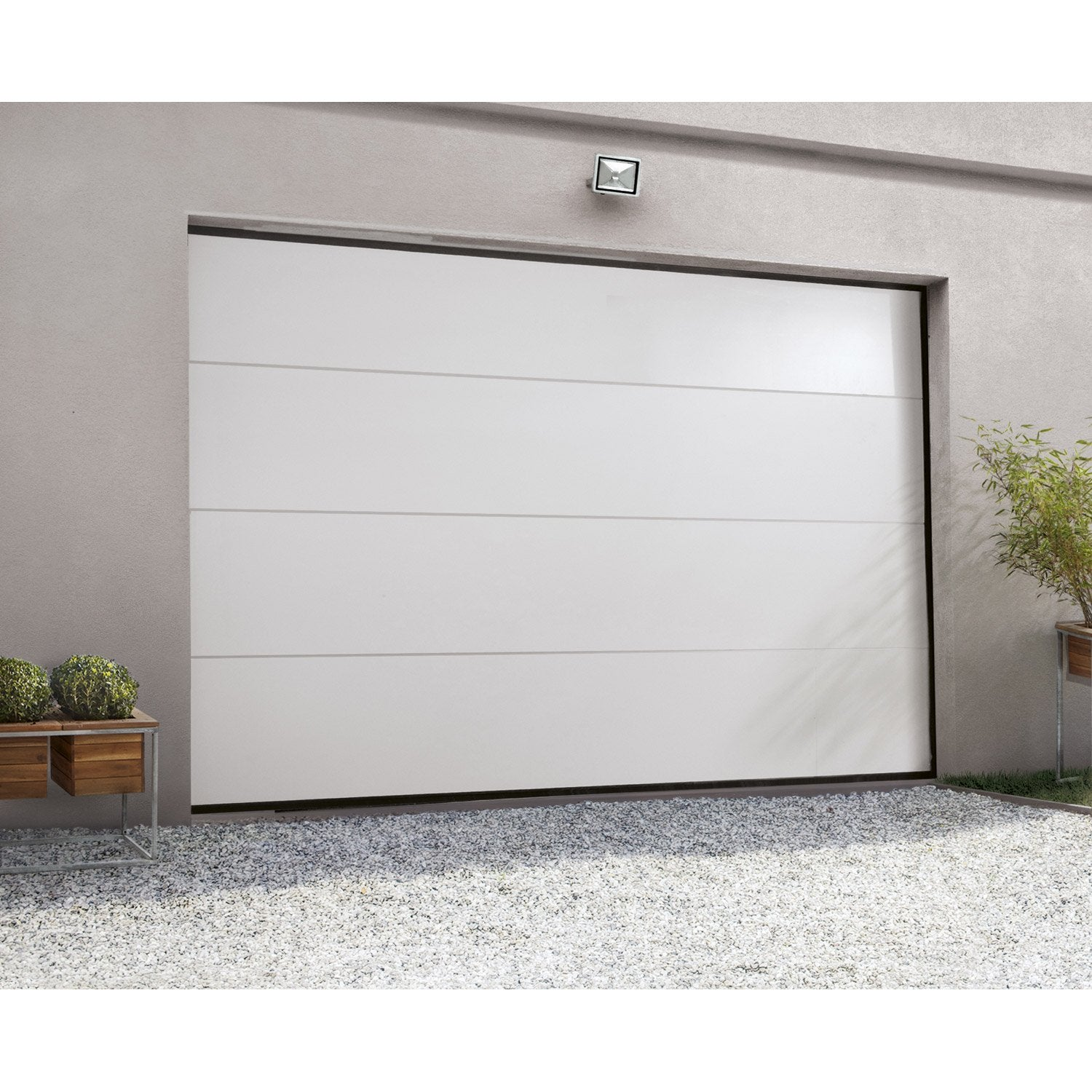 Porte de garage sectionnelle motoris e artens essentiel h for Porte de garage moss