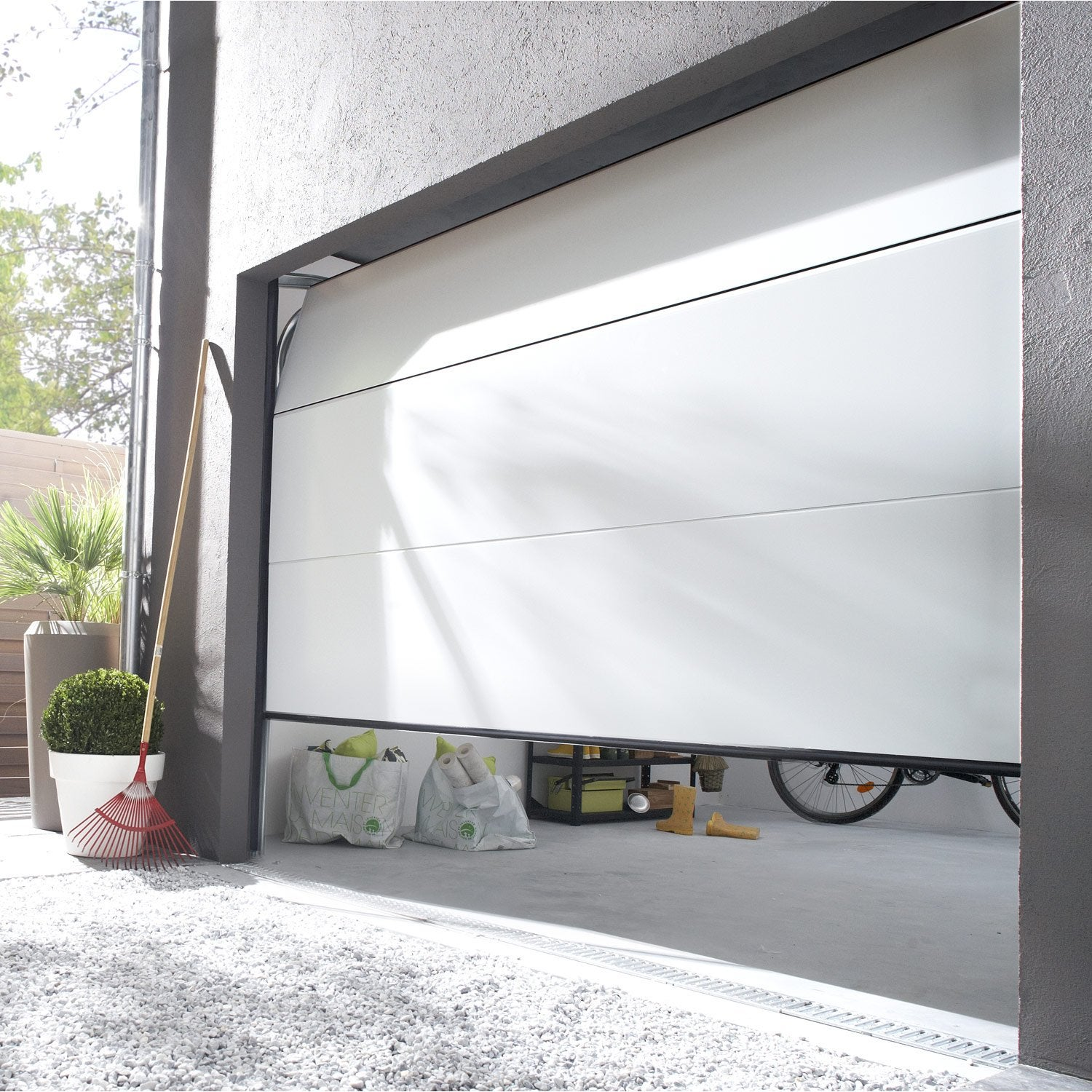 Pose d 39 une porte de garage sectionnelle artens essentiel for Prix pose porte garage